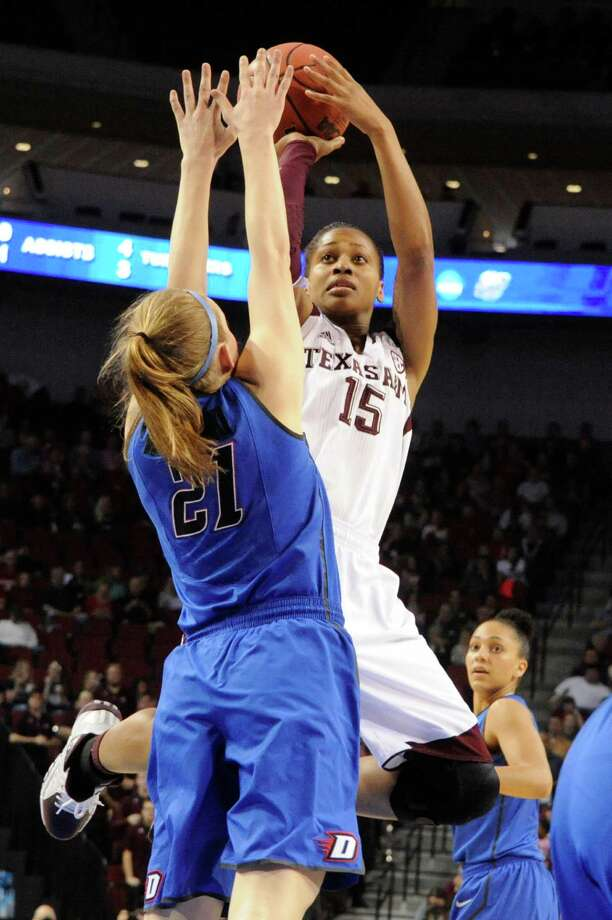 Texas A&M's Tori Scott, right, who had 10 points, shoots over DePaul's Megan Rogowski in the first half. Photo: DAVE WEAVER, FRE / FR67562 AP