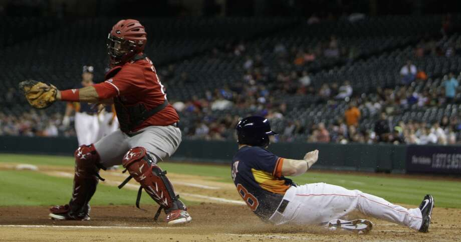 March 29: Astros 2, Veracruz 0  Alex Presley slides safe into home. Photo: Melissa Phillip, Houston Chronicle