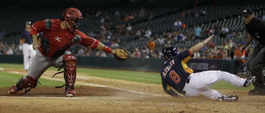 Alex Presley slides safe into home. Photo: Melissa Phillip, Houston Chronicle