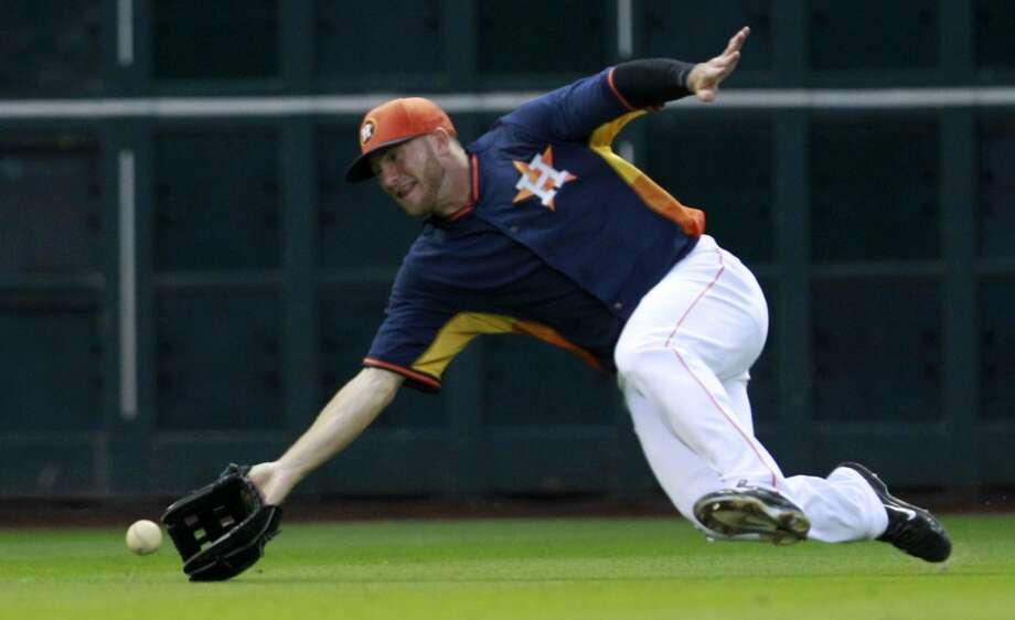 Astros OF Robbie Grossman cannot reach a single hit by Jorge Guzman. Photo: Melissa Phillip, Houston Chronicle