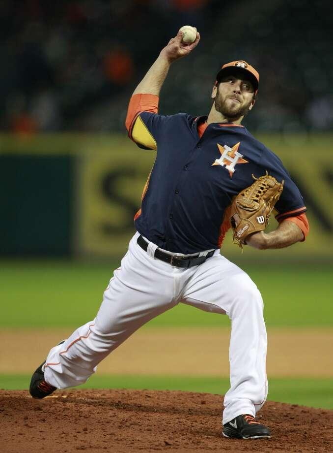 Anthony Bass pitches. Photo: Melissa Phillip, Houston Chronicle