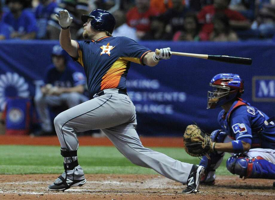 Jonathan Meyer (81) of the Houston Astros hits a grand slam home run during Big League Weekend baseball action against the Texas Rangers in the Alamodome on Saturday, March 29, 2014. Photo: Billy Calzada, San Antonio Express-News / San Antonio Express-News