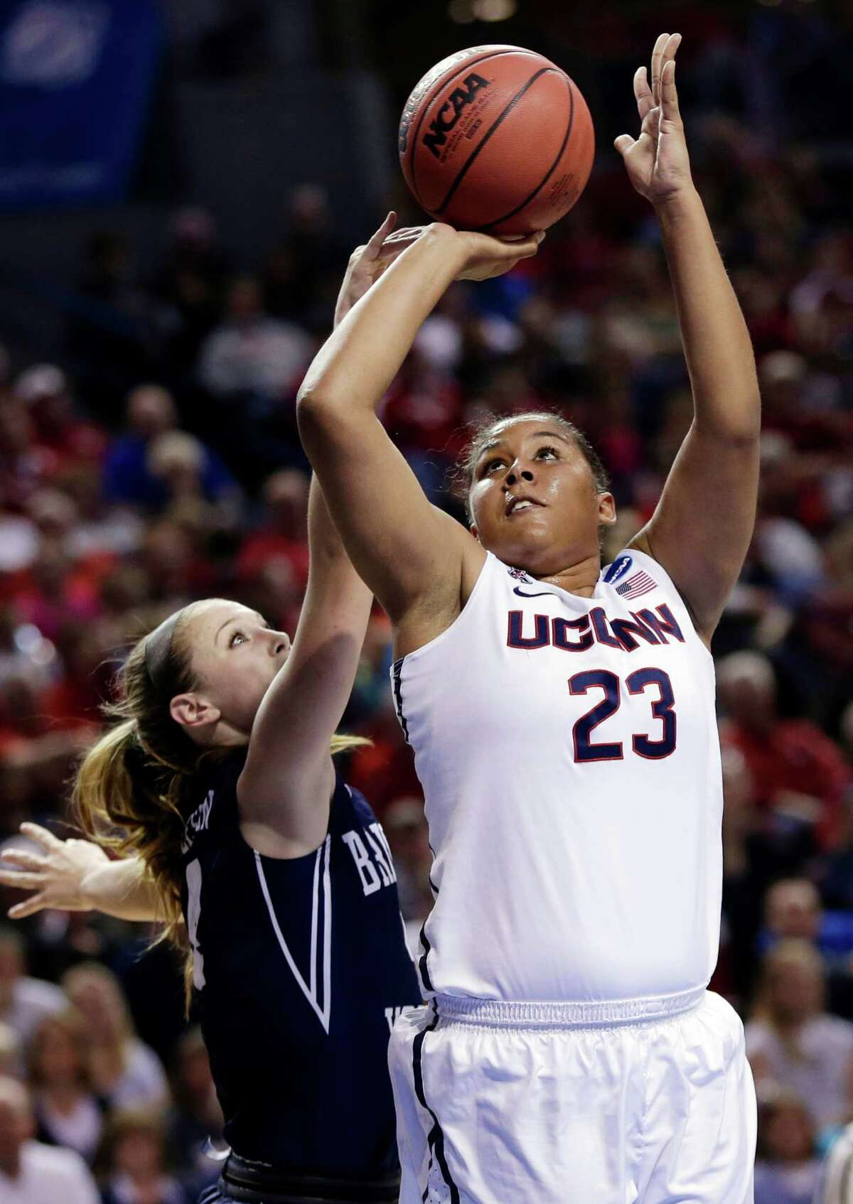 Connecticut's Kaleena Mosqueda-Lewis (23) shoots past BYU's Kim Beeston (4) during the first half of a regional semifinal in the NCAA college basketball tournament in Lincoln, Neb., Saturday, March 29, 2014. (AP Photo/Nati Harnik) ORG XMIT: NENH105