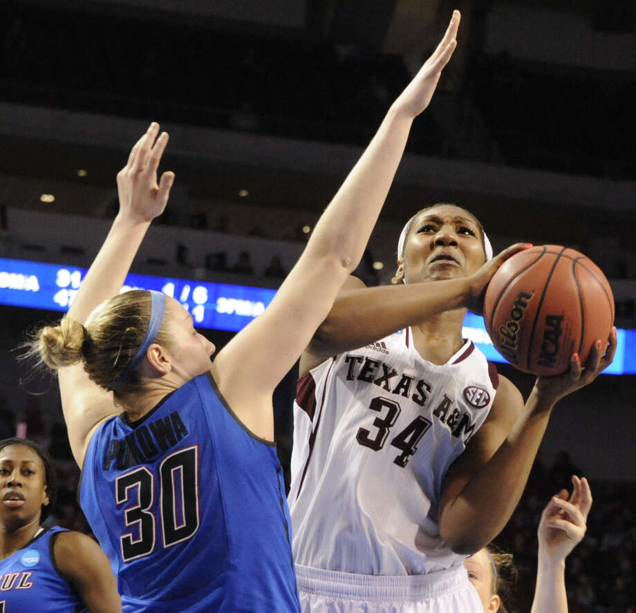 A&M's Karla Gilbert, one of five Aggies in double figures with 11 points, shoots in front of DePaul's Megan Podkowa. Photo: Dave Weaver / Associated Press / FR67562 AP