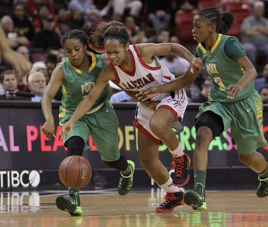 Salesian's Minyon Moore maneuvers between Long Beach Poly's Kyra Brady (left) and Danae Miller in the first half. Photo: Rich Pedroncelli, Associated Press