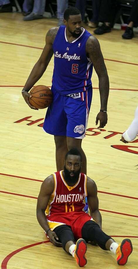 Clippers center DeAndre Jordan stands over Rockets guard James Harden. Photo: James Nielsen, Houston Chronicle