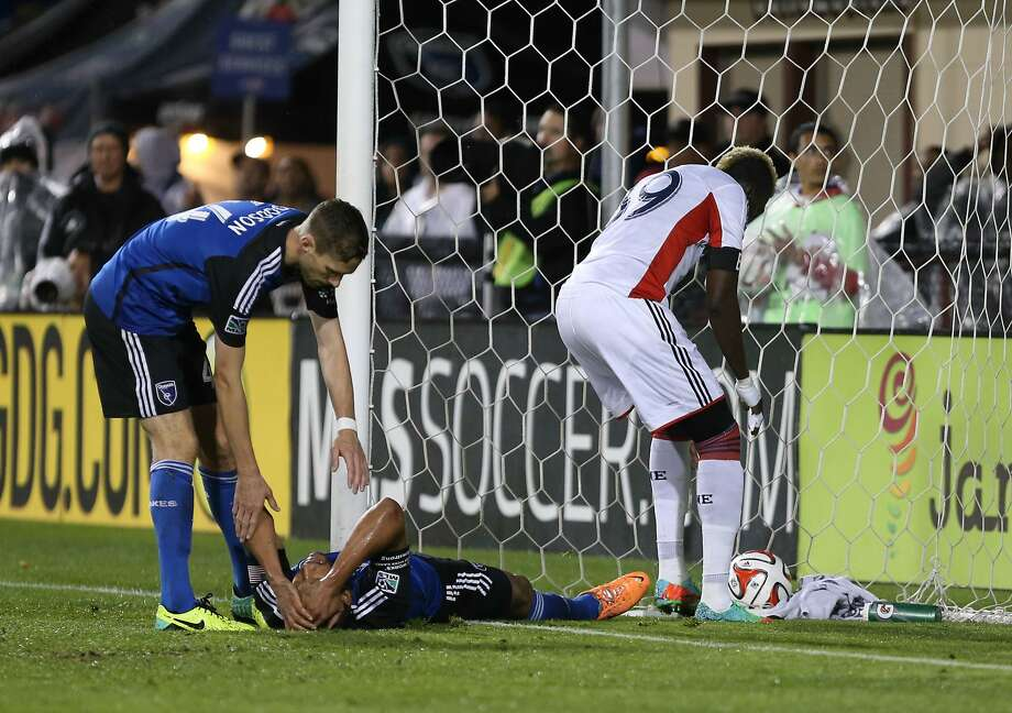 San Jose's Victor Bernardez (on ground) reacts after knocking the ball into the Quakes' goal. Photo: Kelley L Cox, Reuters