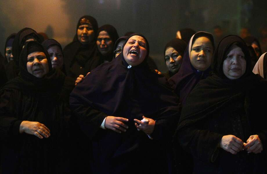 Relatives of 22 year-old journalist Mayada Ashraf, who was killed during clashes between Egyptian police and Muslim Brotherhood supporters, mourn during her funeral in El-Monofiya, north of Cairo, Egypt, Saturday, March 29, 2014. Ashraf, who worked for the privately owned El-Dustour newspaper, was one of four people killed during clashes between security forces and hundreds of supporters of ousted Egyptian president Mohammed Morsi who took to the streets Friday to protest the decision by the country's former military chief to run in upcoming presidential elections. (AP Photo/Ahmed Gomaa) Photo: Ahmed Gomaa, Associated Press