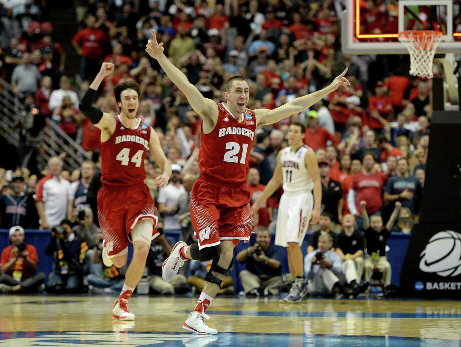 ANAHEIM, CA - MARCH 29:  Josh Gasser #21 and Frank Kaminsky #44 of the Wisconsin Badgers celebrate after defeating the Arizona Wildcats 64-63 in overtime during the West Regional Final of the 2014 NCAA Men's Basketball Tournament at the Honda Center on March 29, 2014 in Anaheim, California. Photo: Harry How, Getty Images / 2014 Getty Images