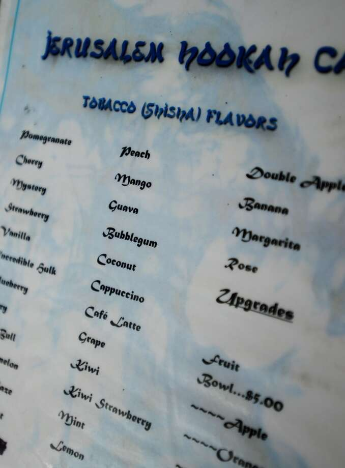Pictured is a list of flavored tobaccos available at the Jerusalem Hookah Cafe on Tuesday. The Jerusalem Hookah Cafe has been serving up Middle Eastern cuisine as well as hookahs to the Beaumont area since 2009. Photo taken Tuesday, 3/18/14 Jake Daniels/@JakeD_in_SETX