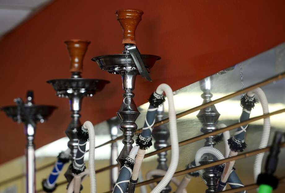 Hookahs for sale at the Jerusalem Hookah Cafe sit on a shelf Tuesday. The Jerusalem Hookah Cafe has been serving up Middle Eastern cuisine as well as hookahs to the Beaumont area since 2009. Photo taken Tuesday, 3/18/14 Jake Daniels/@JakeD_in_SETX