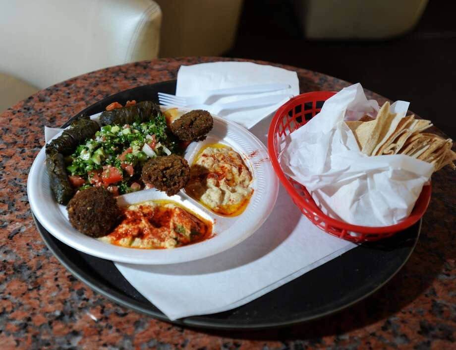 Pictured is the Jerusalem Plate, which is served with pita bread. The Jerusalem Hookah Cafe has been serving up Middle Eastern cuisine as well as hookahs to the Beaumont area since 2009. Photo taken Tuesday, 3/18/14 Jake Daniels/@JakeD_in_SETX