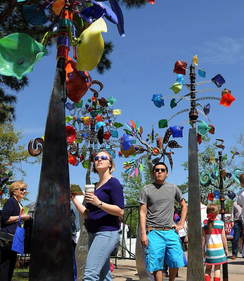 Mandee and Jason Holmes look at kinetic sculptures by Andrew Carson at the Bayou City Art Festival at Memorial Park Saturday March 29, 2014. Photo: Dave Rossman, For The Houston Chronicle
