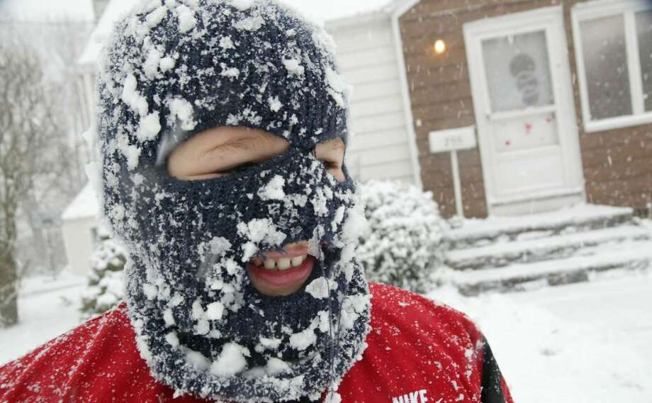 Kyle Ottowell, 8, takes a break from playing in the snow on Wednesday, Feb. 10, 2010. Ottowell was playing with friends on Main Street in Stratford when his face mask iced up. Photo: Phil Noel / Connecticut Post