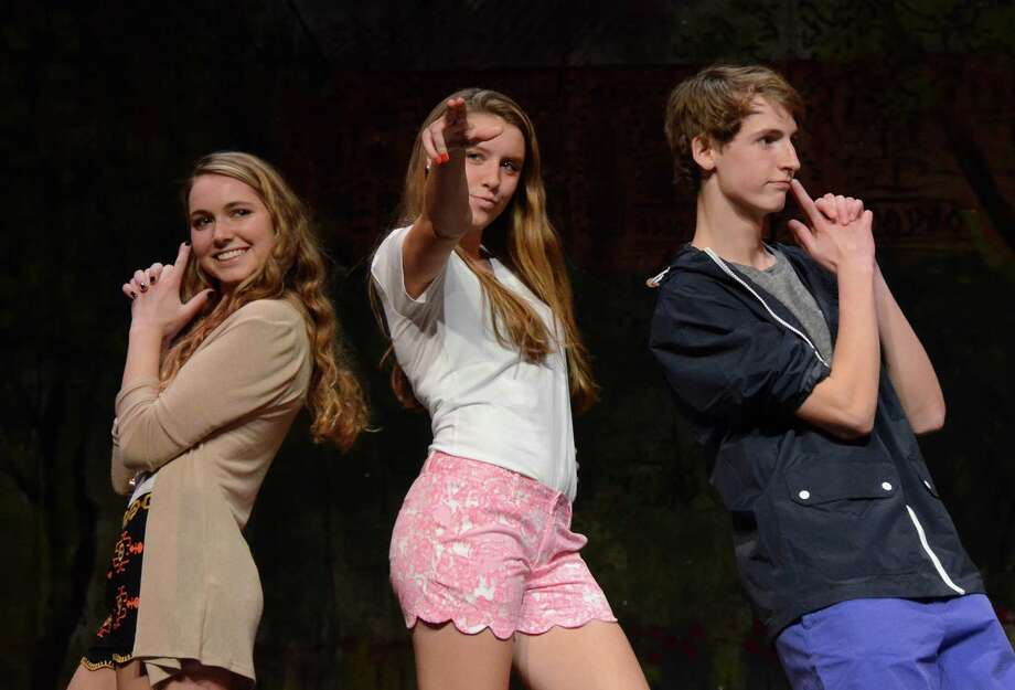 "Isabel Hetherington, Emily Brand, and Jeffrey Cole at the ""College Campus Couture"" senior class fashion show at New Canaan High School, Saturday night, March 29, 2014. Photo: Jeanna Petersen Shepard, Freelance Photo / New Canaan News freelance"