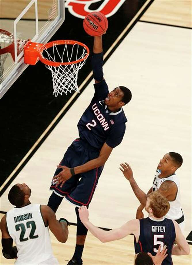 Connecticut forward DeAndre  Daniels (2) scores a basket against Michigan State during the first half  in a regional semifinal at the NCAA college basketball tournament on  Sunday, March 30, 2014, in New York. (AP Photo/Julio Cortez)