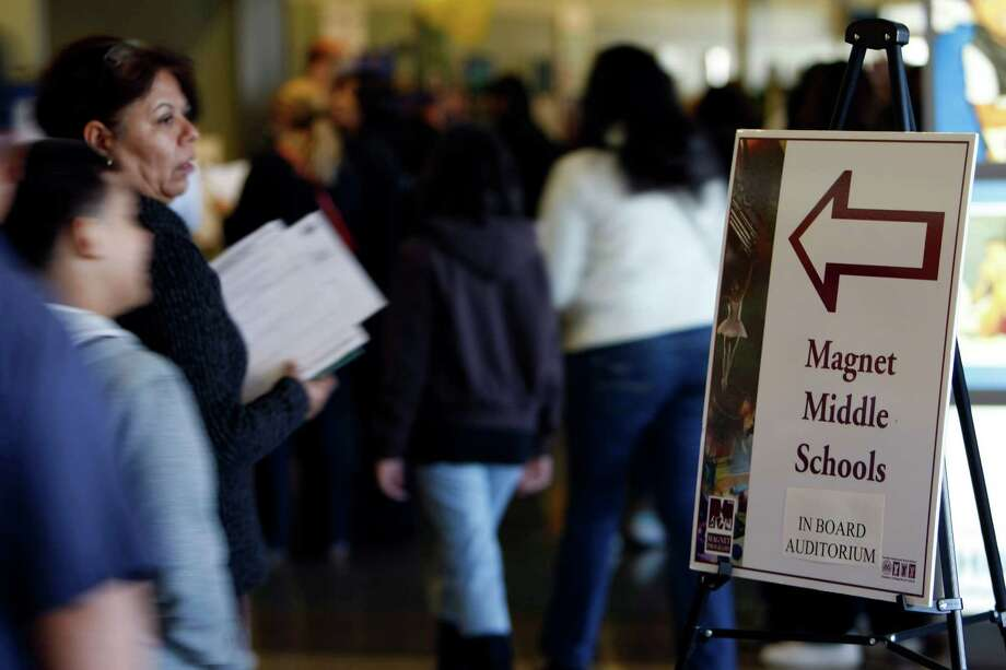 About 2,000 parents and their children attended the HISD Magnet School Program open house at HISD central office Saturday, Nov. 5, 2011, in Houston.  The event featured booths and information from about 120 HISD magnet schools, as well as information sessions. ( Johnny Hanson / Houston Chronicle ) Photo: Johnny Hanson, Staff / © 2011 Houston Chronicle