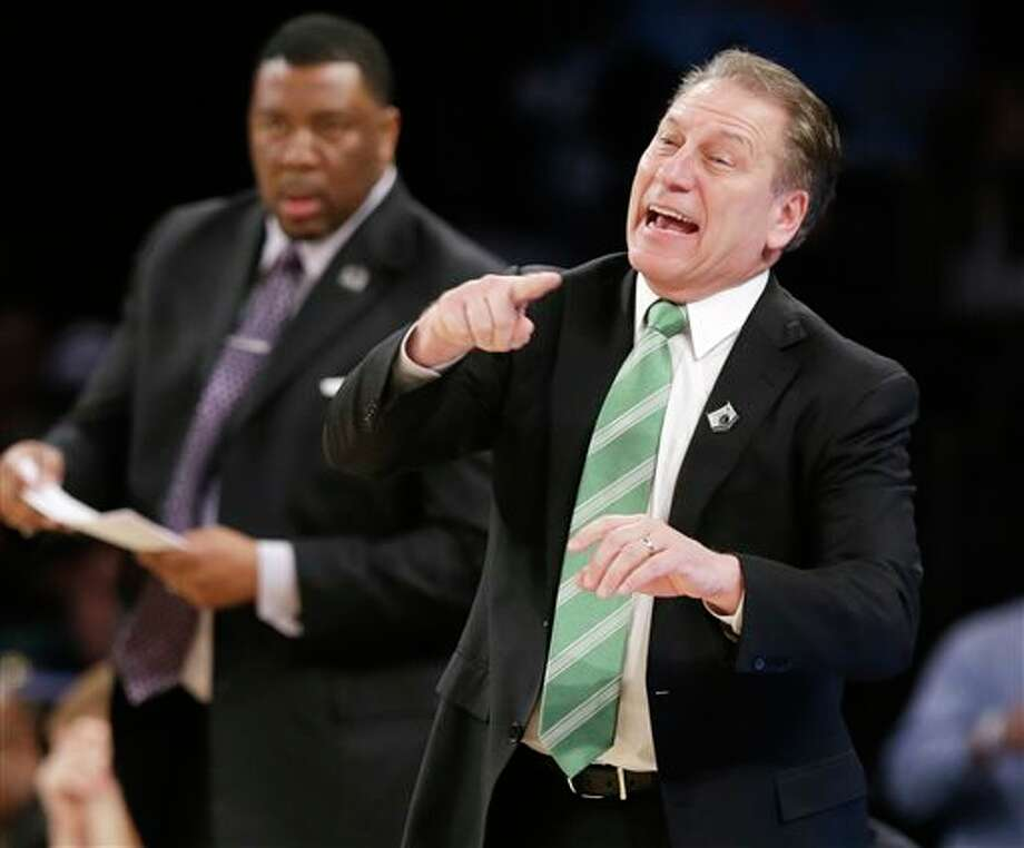 Michigan State head coach Tom  Izzo instructs his team in the first half of a regional final against  Connecticut at the NCAA college basketball tournament on Sunday, March  30, 2014, in New York. (AP Photo/Frank Franklin II)