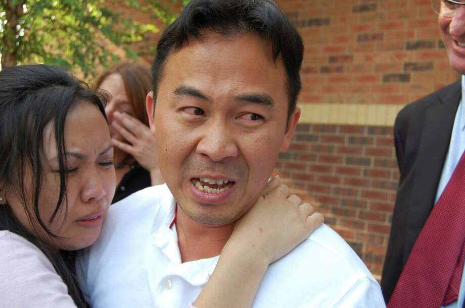 In this Aug. 5, 2010 photo, Koua Fong Lee embraces his wife, Panghoua Moua, outside of the Ramsey County jail, moments after learning that Ramsey County Attorney Susan Gaertner would not seek a new case against Lee in St. Paul, Minn.   Lawmakers are considering a bill that would compensate people who are wrongfully imprisoned in Minnesota, giving them at least $50,000 a year for every year they spent behind bars.  Such a bill could help people like Koua Fong Lee, whose conviction in a crash involving a Toyota was overturned when it was revealed that the car had a problem with sudden acceleration. Lee was exonerated in 2010 after three years in prison. Photo: Tom Weber, AP / Minnesota Public Radio