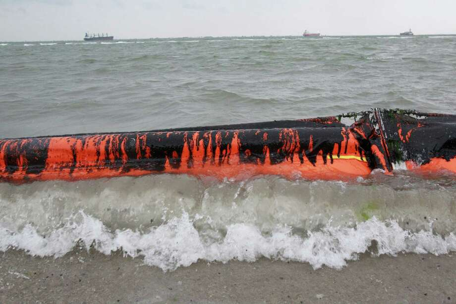 An oil containment boom is shown washed to shore on the beach area along Boddeker Rd. on the Eastern end of Galveston near the ship channel Sunday, March 23, 2014 in Galveston.Latest story: Galveston Bay oil spill could have lasting effect Photo: Melissa Phillip, AP / 2014  HOUSTON CHRONICLE2014