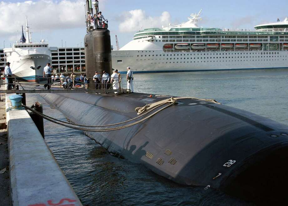 In this April 26, 2004 file photo provided by the U.S. Navy, the USS Miami SSN 755, homeported in Groton, Conn., arrives in port in Fort Lauderdale, Fla. A fire aboard the nuclear-powered submarine on Wednesday, May 23, 2012 at the Portsmouth Naval Shipyard in Kittery, Maine injured four people. Photo: PH2 Kevin Langford, AP / Navy Visual News Service