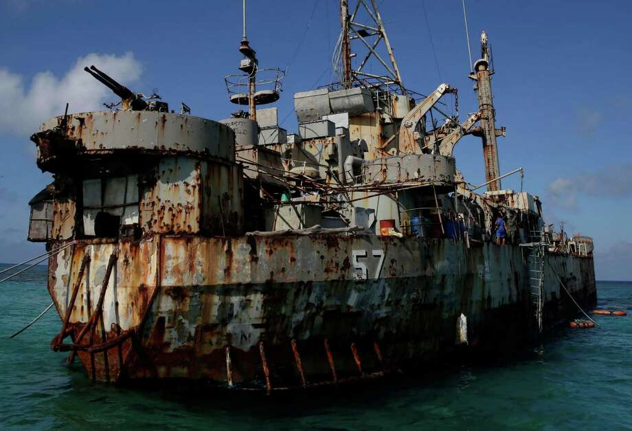 A dilapidated Philippine Navy ship LT 57 (Sierra Madre) with Philippine troops deployed on board is anchored off Second Thomas Shoal, locally known as Ayungin Shoal, Sunday, March 30, 2014 off South China Sea.  On Saturday, China Coast Guard attempted to block the Philippine government vessel AM700 carrying fresh troops and supplies, but the latter successfully managed to docked beside the ship to replace troops who were deployed for five months. Photo: Bullit Marquez, AP / AP