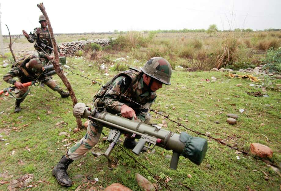 Indian Army soldiers arrive at the site of gun-battle on the outskirts of Jammu, India, Friday, March 28, 2014. Gunmen disguised as Indian soldiers opened fire on a car Friday in Indian-controlled Kashmir, killing a passenger and triggering an hours-long firefight with army troops, authorities said. Photo: Channi Anand, AP / AP
