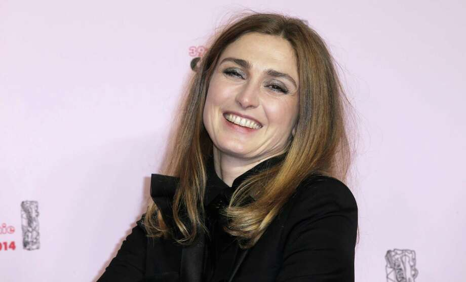 A French court has ordered Thursday March 27, 2014 a gossip magazine to pay $20,000, for publishing photos of what it said was a helmeted President Francois Hollande visiting actress Julie Gayet for a secret tryst. Hollande broke up with his partner Valerie Trierweiler within days of the publication in Closer magazine in January. He has never denied an affair with actress Julie Gayet. In this Feb.28, 2014 file photo, French actress Julie Gayet arrives at the 39th French Cesar Awards Ceremony, in Paris. Photo: Lionel Cironneau, AP / A2014
