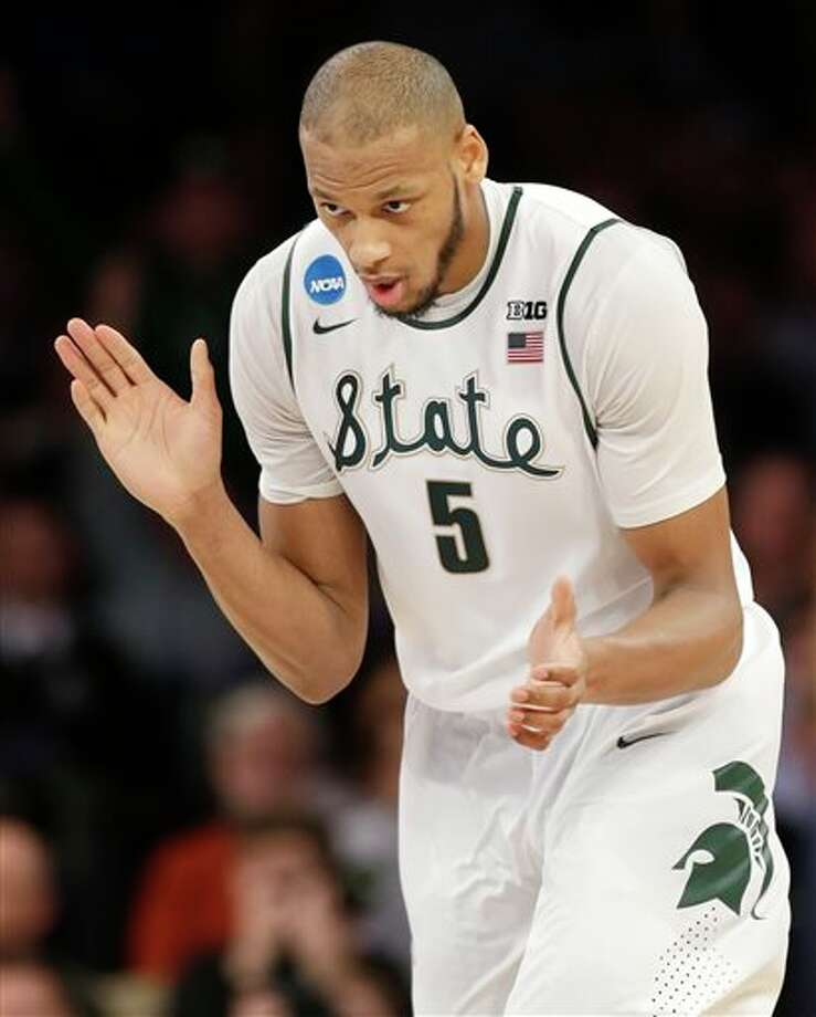 Michigan State's Adreian  Payne reacts in the first half of a regional final against Connecticut  at the NCAA college basketball tournament on Sunday, March 30, 2014, in  New York. (AP Photo/Seth Wenig)