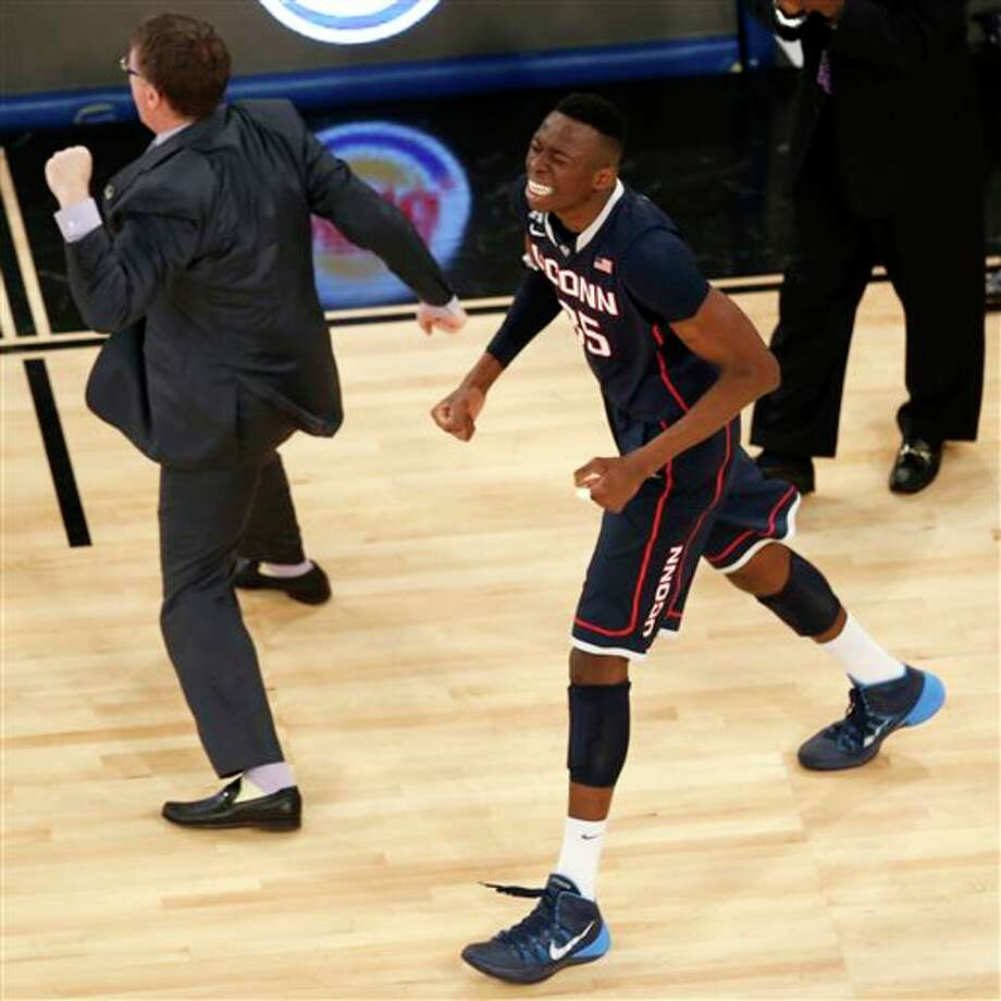 Connecticut guard Tor Watts  (25) reacts during the second half in a regional semifinal at the NCAA  college basketball tournament against Michigan State, Sunday, March 30,  2014, in New York. (AP Photo/Julio Cortez)