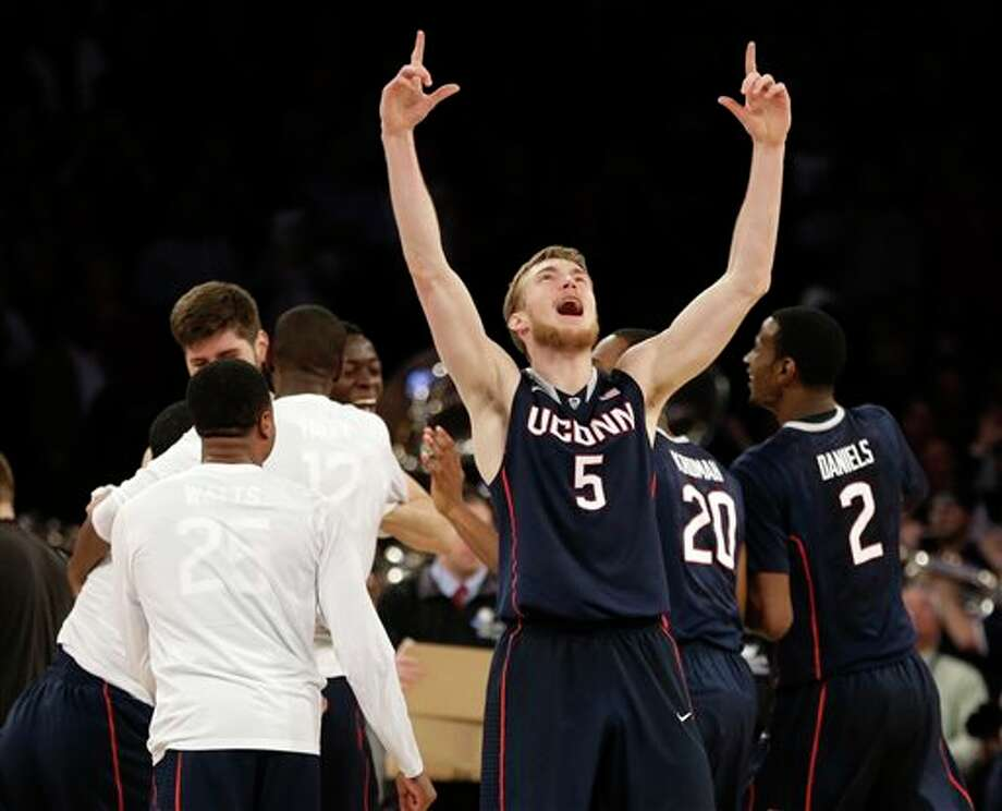 Connecticut's  Niels Giffey celebrates after his team beat Michigan State 60-54 in a  regional final at the NCAA college basketball tournament, Sunday, March  30, 2014, in New York. (AP Photo/Seth Wenig)