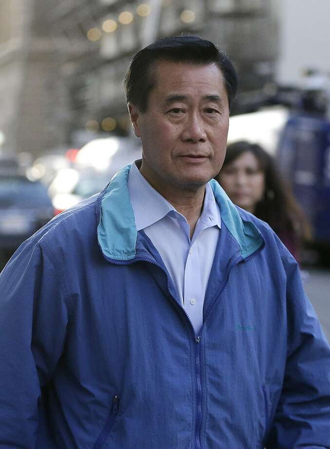 California Sen. Leland Yee, D-San Francisco, right, leaves the San Francisco Federal Building, Wednesday, March 26, 2014, in San Francisco.  The FBI has filed a 137-page affidavit outlining a detailed corruption case against Yee, who is accused of asking for campaign donations in exchange for introducing an undercover agent to an arms trafficker. (AP Photo/Ben Margot) Photo: Ben Margot, Associated Press