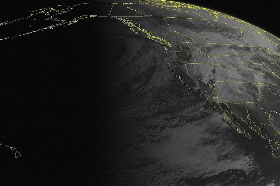 A satellite image shows a major storm approaching the western United States. Photo: Associated Press
