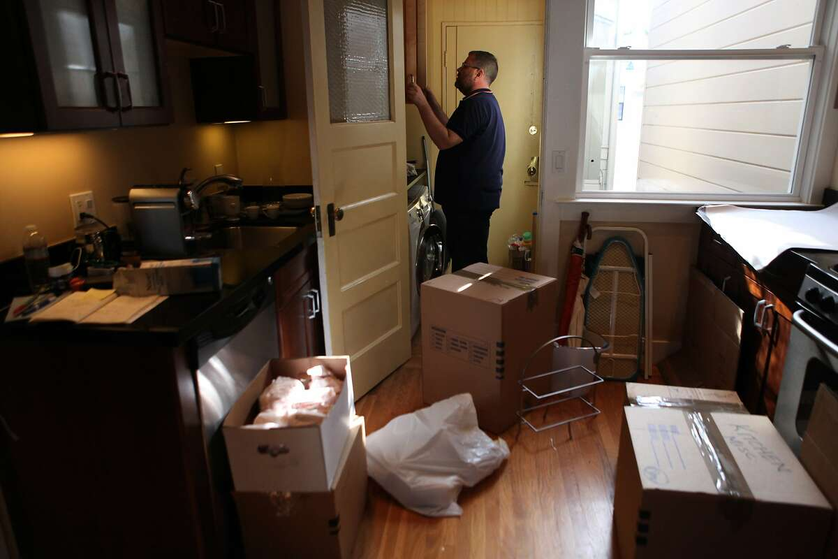 Dan Kennedy packs some of his last stuff as he moves out of his old unit and into a place he just bought, in San Francisco, Calif. on March 30, 2014.