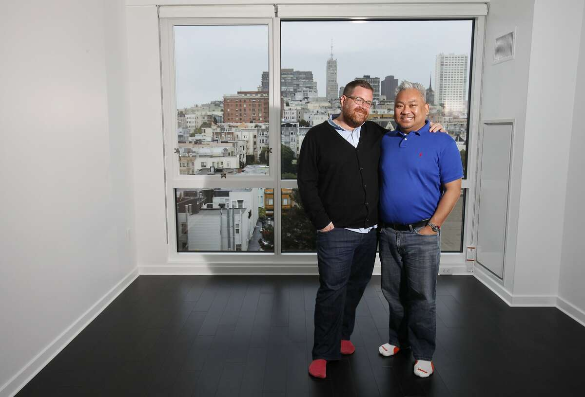 Daniel Kennedy, left, and Alek Chainam pictured March 29, 2014 in their new apartment in San Francisco, Calif.