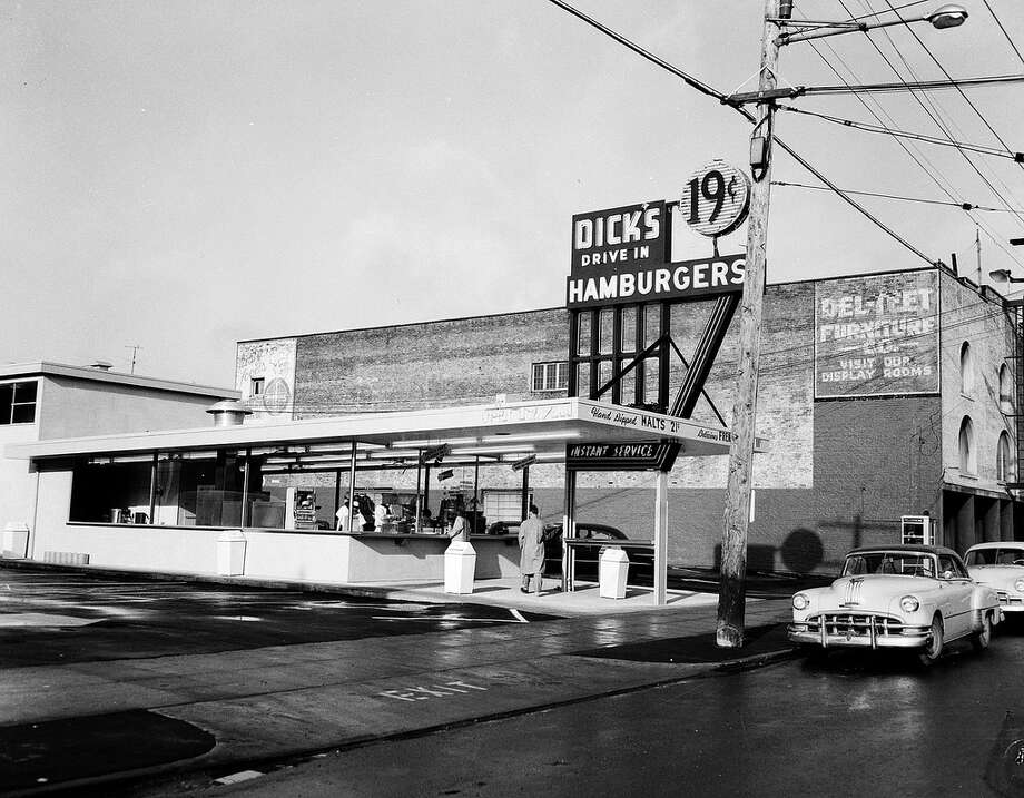 Dick's Drive-In: The first Dick's opened in 1954 in Wallingford, and the sparse menu of burgers, shakes and fries has changed little since. (Pictured: Dick's on Broadway, 1955, from Seattle Municipal Archives).