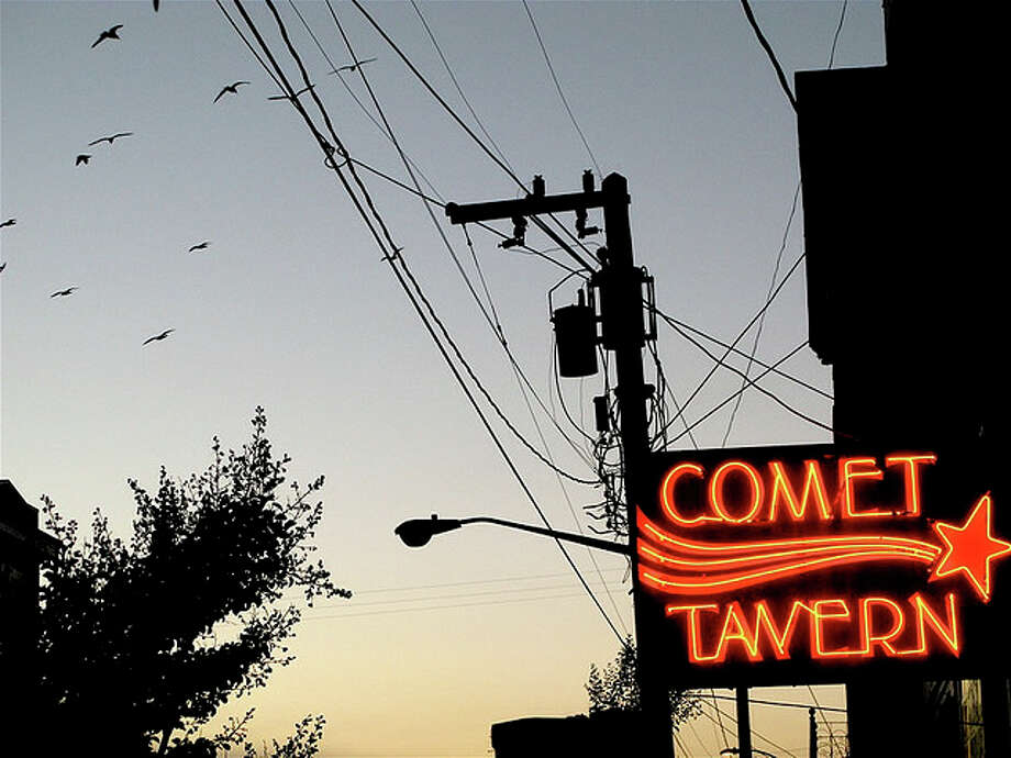 The Comet Tavern:Capitol Hill's famous dive bar may not be Seattle's oldest - it opened in the '50s - but it has a long history as a hangout for hippies and musicians. It re-opened on Mar. 31, 2014, after going dark for about five months. (Photo: stab at sleep, Flickr).