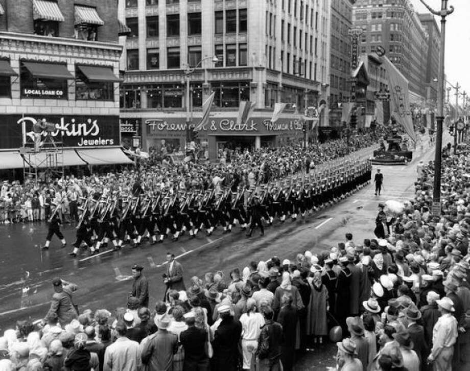 "Torchlight parade:Seafair's great public party, Torchlight, began as the ""Grande Parade."" It still draws thousands of people and strong opinions among Seafair lovers and haters. (Photo: 1955). Photo: P-I File / P-I file"