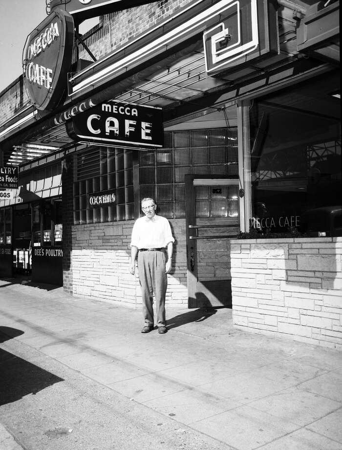 Mecca Café & Bar: A lot's changed in lower Queen Anne (Easy Street Records is now Chase Bank; drunk Sonics fans are no more). But the Mecca has remained true to its tiny dive-bar core since its 1930s opening.  (Photo: 1954, Seattle Municipal Archives).