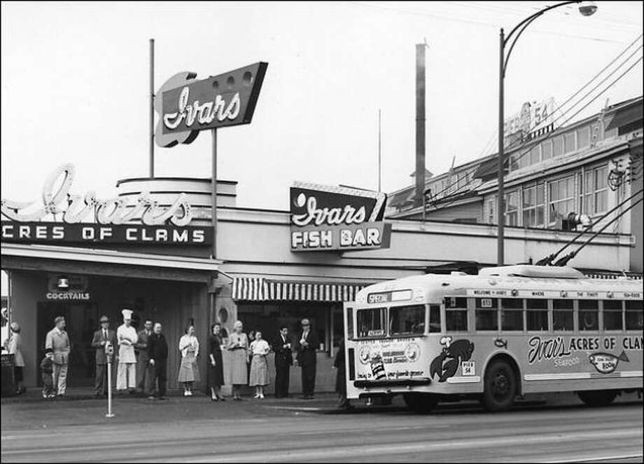 Ivar's:Seattle folk singer Ivar Haglund opened his first fish and chips bar in 1938, which had a short life. He then opened Ivar's Acres of Clams, pictured, on the waterfront in 1946. A half-century later, Ivar's is still an endearing local brand. (Photo: 1950, courtesy Ivar's).