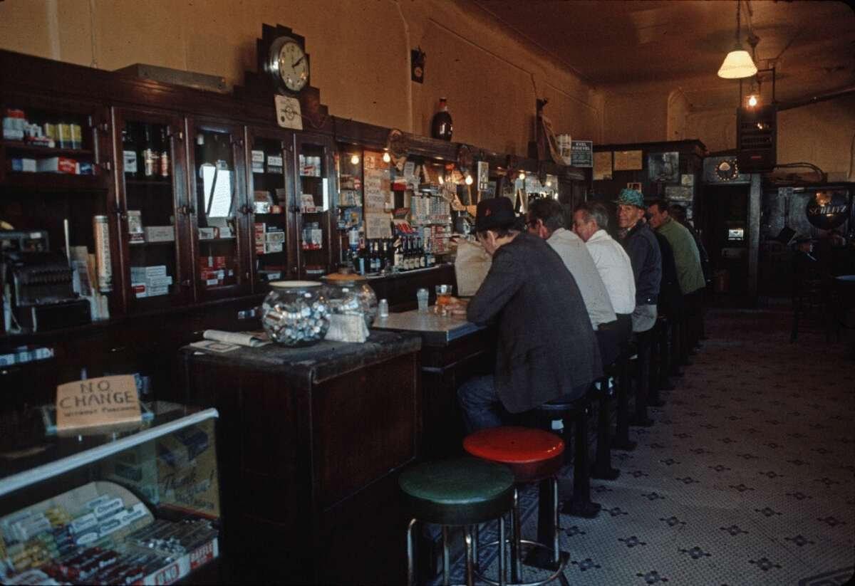 """Right: The food This Belltown restaurant and bar has been around since 1903, and appeared in the movie """"Sleepless in Seattle."""" Two decades later, the menu's fancier and the crowd is more touristy, but the vibe is still laidback. (Photo: Seattle Municipal Archives)."""