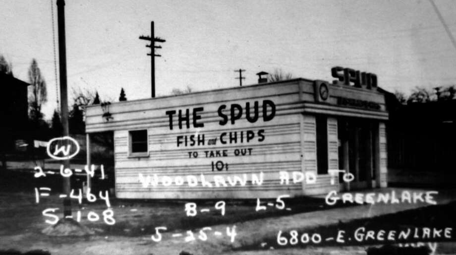 Spud Fish & Chips: Sometimes all you need is fried food wrapped in paper and a rubber band at the beach. That's probably how it was in 1934, when Spud opened its first fish and chips stand in Alki. (Photo: Green Lake's first Spud Fish and Chips stand in 1941, from Puget Sound Regional Archives).