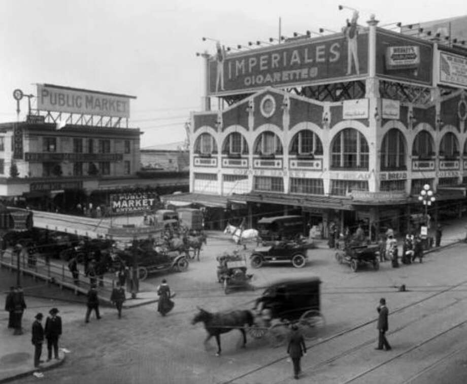 Pike Place Market: The ultimate in old (and touristy) Seattle. The market opened in 1907 to help farmers sell directly to consumers and cut out price-gouging middlemen.(Photo: copyright MOHAI, 1915, Webster & Stevens, 1983.10.10020).