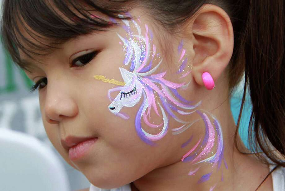Elyanna Santos, 5, sees her unicorn face painting she requested during the McDonald's Houston Children's Festival at City Hall on March 27, 2014, in Houston, Tx. The festival benefits Child Advocates Inc. and presented by Baker Hughes. Photo: Mayra Beltran, Houston Chronicle / © 2014 Houston Chronicle