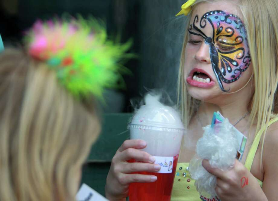 Jewels Westra, 7, waits for the smoke to clear from her 'volcano drink' during the McDonald's Houston Children's Festival at City Hall on March 27, 2014, in Houston, Tx. The festival will benefit the  Child Advocates Inc. and presented by Baker Hughes. Photo: Mayra Beltran, Houston Chronicle / © 2014 Houston Chronicle