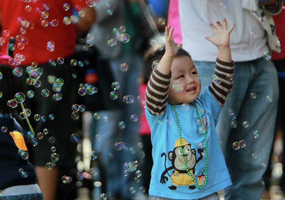 Ryan Chen, 2, chases bubbles during the McDonald's Houston Children's Festival at City Hall on March 27, 2014, in Houston, Tx. The festival will benefit the  Child Advocates Inc. and presented by Baker Hughes. Photo: Mayra Beltran, Houston Chronicle / © 2014 Houston Chronicle
