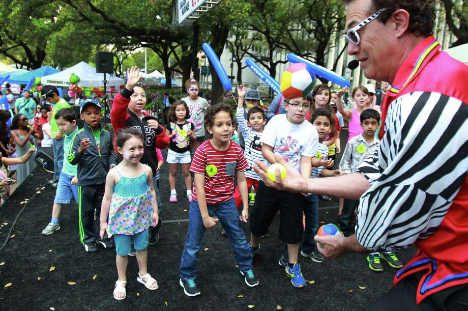 Juggler Claude Sims entertains children during the McDonald's Houston Children's Festival at City Hall on March 27, 2014, in Houston, Tx. The festival will benefit the  Child Advocates Inc. and presented by Baker Hughes. Photo: Mayra Beltran, Houston Chronicle / © 2014 Houston Chronicle
