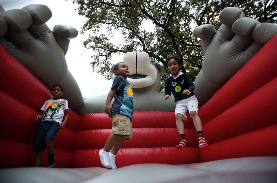 Children play in the Houston Rockets Jumper during the McDonald's Houston Children's Festival at City Hall on March 27, 2014, in Houston, Tx. The festival will benefit the  Child Advocates Inc. and presented by Baker Hughes. Photo: Mayra Beltran, Houston Chronicle / © 2014 Houston Chronicle