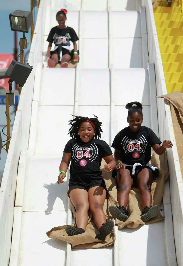 Kirsten Farrington, 10, and Maddison Haynes, 11, enjoy carnival slide ride during the McDonald's Houston Children's Festival at City Hall on March 27, 2014, in Houston, Tx. The festival will benefit the  Child Advocates Inc. and presented by Baker Hughes. Photo: Mayra Beltran, Houston Chronicle / © 2014 Houston Chronicle