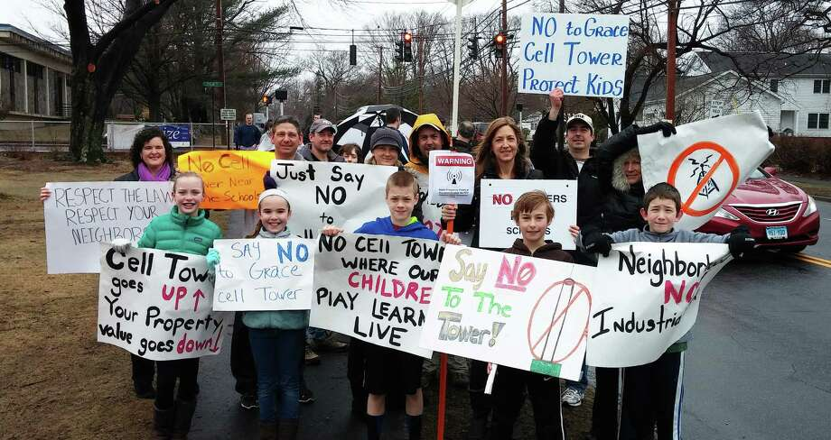 Dozens of people gathered outside Grace United Methodist Church on Fairfield Woods Road Sunday to protest a cell phone tower proposed to be erected on the church's property Photo: Andrew Brophy / Fairfield Citizen